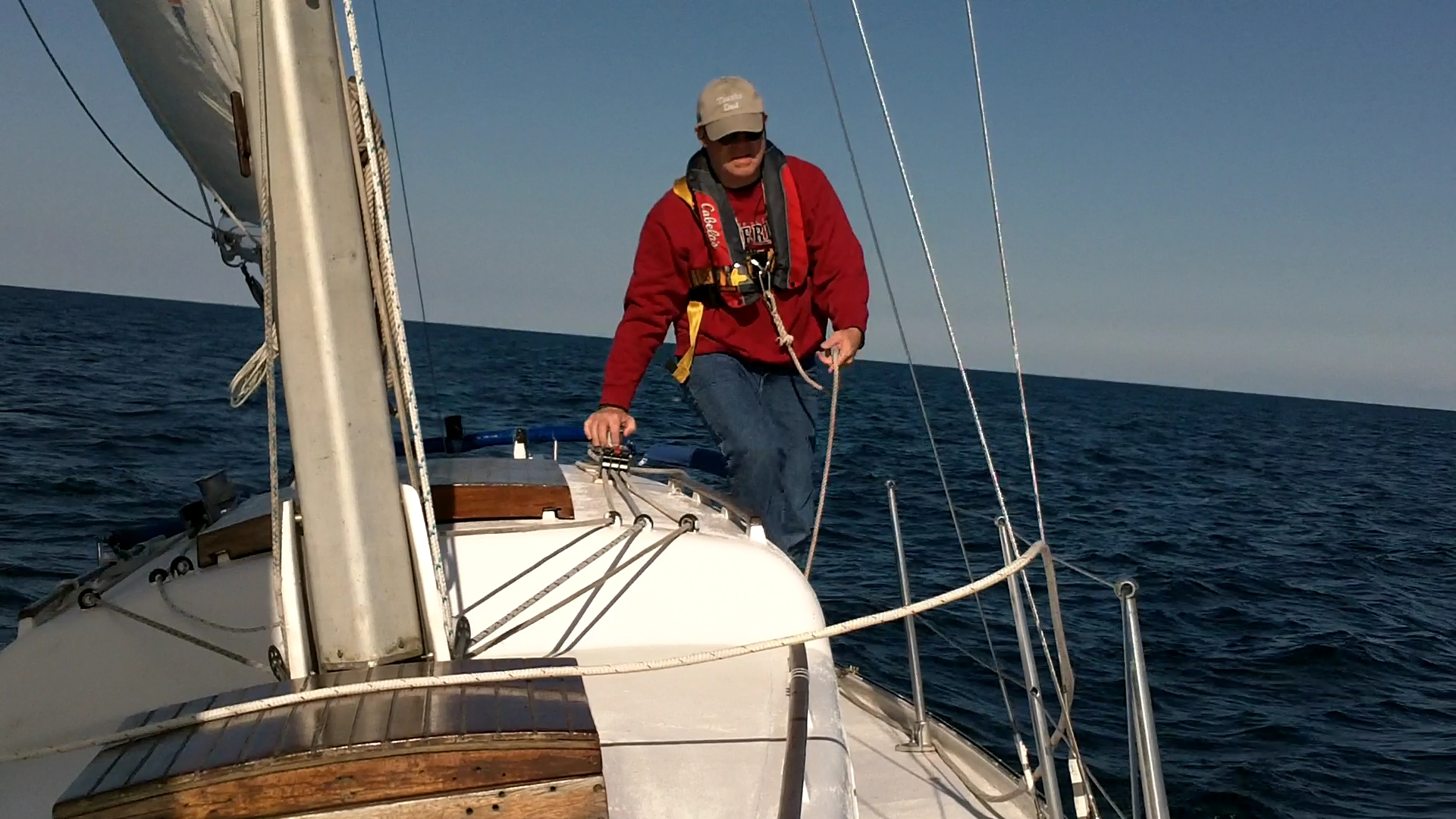 Always wearing a PFD and harness when sailing alone.